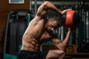 Muscular-man-exercising-with-medicine-ball