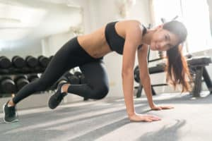 female-client-smiling-at-weight-loss-training